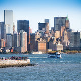 Statue ferry on its way to Liberty Island in front of New York s stock photos
