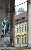 Statue. At the Field Marshal's hall in Munich (Feldherrnhalle – Odeonsplatz) with the domes of the Frauenkirche in the background royalty free stock photos