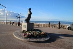 Statue of fishermans wife at the coast of Scheveningen close to The Hague,to remember all fishermen which never came back to home. Statue of fishermans wife at royalty free stock images