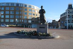 Statue of fishermans wife at the coast of Scheveningen close to The Hague,to remember all fishermen which never came back to home. Statue of fishermans wife at stock photos