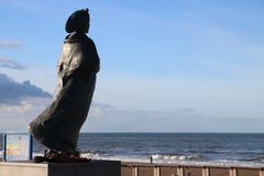 Statue of fishermans wife at the coast of Scheveningen close to The Hague,to remember all fishermen which never came back to home. Statue of fishermans wife at royalty free stock photos