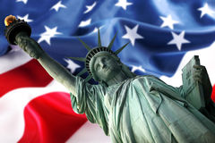 Statue and flag. NY Statue of Liberty against a flag of USA Royalty Free Stock Photography