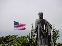 Statue and flag Stock Photo