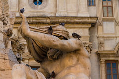 Statue the Fontana dei Quattro Fiumi with pigeons Stock Photos