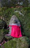Statue at forest in Yamadera, Japan. A stone statue at sacred forest in Yamadera, Japan. Yamadera is a scenic temple located in the mountains northeast of Stock Photography