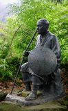 Statue at forest in Yamadera, Japan. Yamadera, Japan - Dec 5, 2016. A statue at Yamadera Risshakuji Temple. Yamadera is a scenic temple located in the mountains Stock Photo