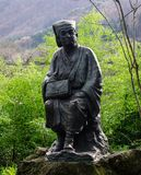 Statue at forest in Yamadera, Japan. Yamadera, Japan - Dec 5, 2016. A statue at Yamadera Risshakuji Temple. Yamadera is a scenic temple located in the mountains Stock Photos