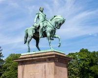 Statue of former Swedish and Norwegian King Karl XIV Johan sitting on a horse. Royalty Free Stock Images