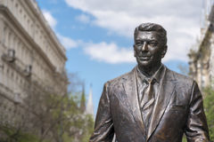 Statue of the former U.S. President Ronald Reagan. BUDAPEST, HUNGARY - APRIL 19, 2015: Statue of the former U.S. President Ronald Reagan on the background of Stock Photos