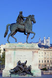 Statue and Fourviere basilic. Famous statue of Louis and Fourviere basilic on a background Stock Image