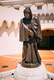 Statue of Francois Grimaldi disguised as a monk with a sword und Stock Photo