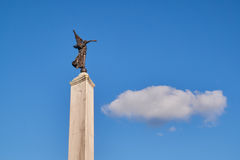 Statue of freedom angel pointing at cloud on blue sky Royalty Free Stock Photos