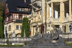 Statue in front of beautiful Peles castle in Sinaia, Romania, between Valachia and Transylvania Royalty Free Stock Photo