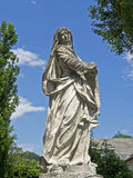 Statue in front of Calvary Hill. White stone statue in front of Graz Calvary Hill, Austria Royalty Free Stock Photo