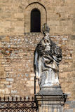 Statue in front of the Cefalu Cathedral in Cefalu, Sicily, Italy Royalty Free Stock Images