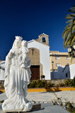 Statue in front of church. Old church in Estepona, situated near the port Stock Photos