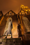 Statue in front of a church in Groningen, Netherlands. Night scene of Statue in front of a church in Groningen, Netherlands Stock Image