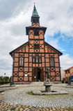 Statue in front of the church  timbered Stock Image