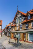 Statue in front of colorful houses in Wernigerode Royalty Free Stock Photo