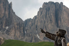 Statue in front of dolomites Stock Photos