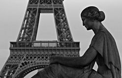 Statue in front of Eiffel Tower, Paris, France. A stone statue sits in front of the Eiffel Tower in Paris, France Royalty Free Stock Image