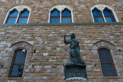 Statue in front of the Facade of Old Palace called Palazzo Vecchio at the Piazza della Signoria in Florence, Tuscany, Italy Stock Image