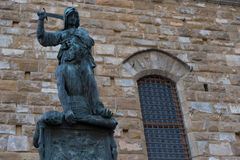 Statue in front of the Facade of Old Palace called Palazzo Vecchio at the Piazza della Signoria in Florence, Tuscany, Italy Royalty Free Stock Photo