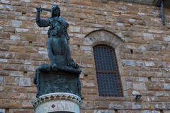 Statue in front of the Facade of Old Palace called Palazzo Vecchio at the Piazza della Signoria in Florence, Tuscany, Italy Stock Photos