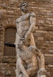 Statue in front of the Facade of Old Palace called Palazzo Vecchio at the Piazza della Signoria in Florence, Tuscany, Italy Royalty Free Stock Photos