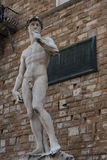 Statue in front of the Facade of Old Palace called Palazzo Vecchio at the Piazza della Signoria in Florence, Tuscany, Italy Stock Photo