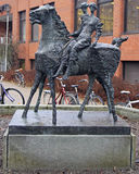 Statue in front of Hameenlinna public library, Finland. Hameenlinna, Finland - April 6, 2017: statue in front of Hameenlinna public library, Finland royalty free stock image