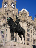 Statue in front of the Liver Buildings. Statue of King Edward in front of the Liver Building Stock Photos