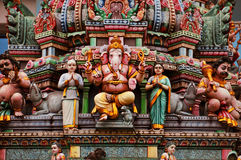 Statue of Ganesh on a colorful indian temple facade. Statue of Ganesh and other hindu gods on a colorful indian temple facade Royalty Free Stock Photography