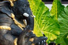 Statue Ganesha in a garden of balinese house stock photo