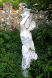 Statue in garden Royalty Free Stock Photo