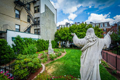 Statue and gardens at St. Leonard`s Church, in the North End of. Boston, Massachusetts Royalty Free Stock Images