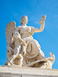 Statue with garland at facade of Versailles Royalty Free Stock Photos