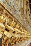 Statue of garuda. The statue garuda fairy tale animal of thai buddhist native on the temple wall at wat prokeaw temple in bangkok province, metropolis of Stock Photo