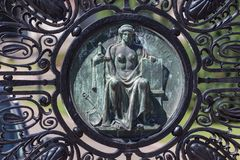 Statue on a gate at the international court of justice freedom palace the hague netherlands. A statue on a gate at the international court of justice freedom royalty free stock image