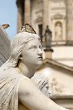 Statue in Gendarmenmarkt. A couple of birds on the head of a statue, Berlin Royalty Free Stock Images