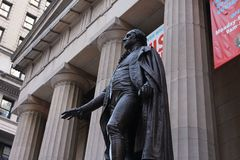 Statue of George Washington at Federal Hall in New York City. A statue of George Washington standing in front of Federal Hall on Wall Street in lower Manhattan royalty free stock photos