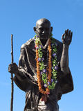 Statue of Ghandi wearing real leis Stock Images