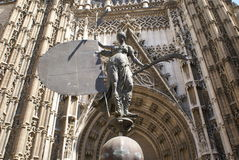 Statue of Giraldillo in Seville Cathedral, Seville, Spain. The statue of the entrance of the Spanish landmark The Cathedral of Saint Mary of the See stock images