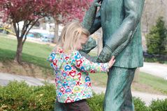 A statue and a girl Royalty Free Stock Photos