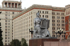 The statue of a girl with a book next to the entrance to the main building of Moscow State University, MSU  Royalty Free Stock Photo