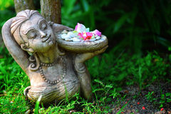 Statue of a girl. With a tray of green royalty free stock image
