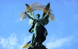 The triumphant statue of Glory on the Opera theatre in Lviv with an Ukrainian flag royalty free stock image