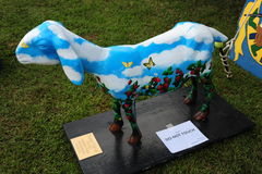 Statue of a  Goat painted with clouds and butterflies. Stock Image