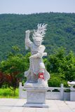 Statue of the god in China, Dalian. Statue of the god in China, costing on mountain Stock Photo