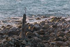Statue of the god Neptune on a cliff royalty free stock photos
